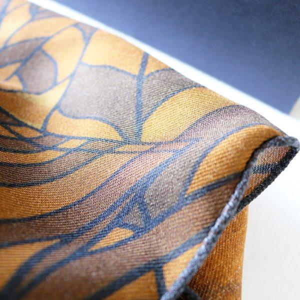 chèche laine soie finition frangée roulottée Maison Fétiche cuir beige noir Afrique rhinocéros homme 70 x 185